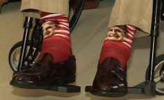 George H.W. Bush wearing socks with pictures of his face on them.