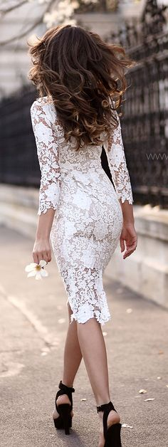 white lace dress with a pair of black heels