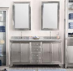 stainless steel double vanity from restoring   Stainless steel vanity.... On grey plank floor