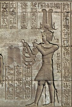 Roman emperor Trajan depicted as pharaoh offering necklace to goddess Hathor with clips depicting face of goddess herself, relief of Mammisi (birth temple), Temple of Hathor, 88-51 BC, Dendera, Egypt, Ptolemaic Period