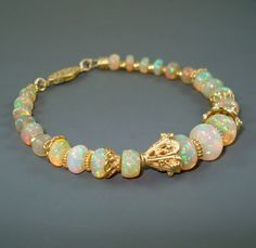 Opal Bracelet Ethiopian Fire Opals and Vermeil by JewelryByJacoby. VP: Etsy.com Awesome opals!