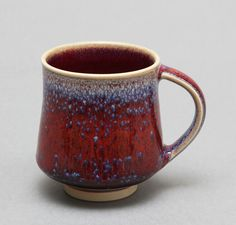 Wheel-thrown Porcelain Mug with red and blue speckles by Hsinchuen Lin. via Etsy.
