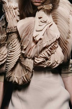 Givenchy AW06/07 - Beautiful fabric manipulation + texture.  This looks like a contour model!