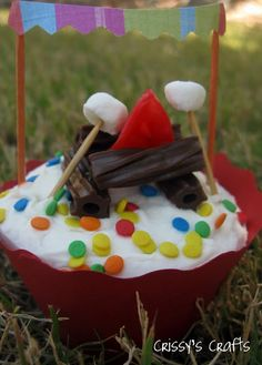 Camping theme cupcake.. Super cute for a lil boys bday party or kids camp out party!!