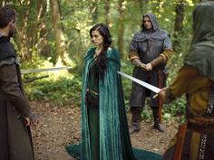 """Careful boys,"" said the woman in the green hood, ""those swords are sharp. You could hurt yourselves."""