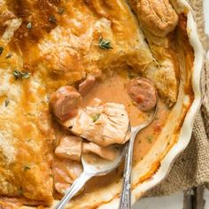 A rich pot pie filled with chicken bacon and andouille sausage. Cooked with cajun style spices and topped with a thick layer of puff pastry to finish it off