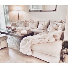 add a white coffee table (or glass combo) with this color couch and the warm floor white rug and good to go!!