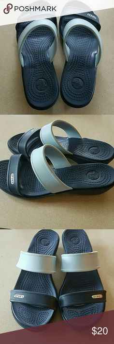 Light blue and dark navy crocs sandals One thinner navy strap and a thicker light blue strap, slight heel, easy to walk in, perfect for summer, gently used CROCS Shoes Sandals