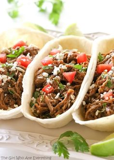 These Barbacoa Tacos are cooked in the slow cooker all day so you can come home to savory and spicy tacos. the-girl-who-ate-everything.com