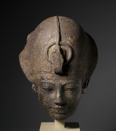 The head of Amenhotep III wearing the blue crown-Egypt, New Kingdom, Dynasty 18, reign of Amenhotep III    Date: c. 1391-1353 BC    Medium: granodiorite
