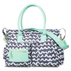 Tote baby essentials in this fun patterned diaper bag that has tons of pockets.