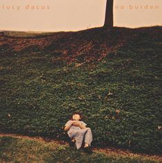 """""""Trust"""" by Lucy Dacus from the album No Burden:     If beauty is the only way   to make the nightmares go away,   I'll plant a garden in your brain   and let the roots absorb the pain."""