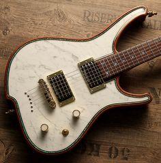 Gorgonized Nemesis with real White Italian Carrara Marble stone top. Insane artwok - insane sound !! Find out more at www.zerberus-guitars.de