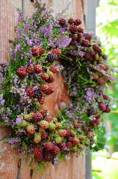 A wreath with heather and blackberries - small tribute in August.| Lilies and tulips