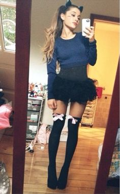 I think her hair looks so cute like that with the cat ears! Might have to try this one year for halloweenie