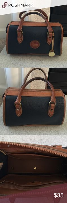 Dooney & Bourke Bag Small Dooney & Bourke Bag; Good condition for its age; missing strap & leather clasps that hold zipper in place (see pix). Dooney & Bourke Bags