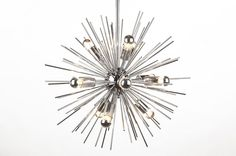 Our Modern Starburst Pendant Light is crafted of sleek chromed carbon steel rods that radiate in a random starburst pattern. Illumination from twelve chromed E26 40W bulb (MAX; not included) reflects