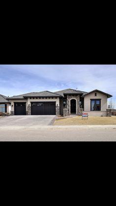 Ranch with black garage doors