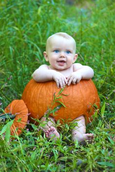 Baby in a pumpkin- Halloween or Fall photo.