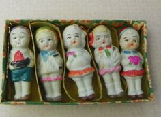 1930's-40's Frozen Charlotte Penny Dolls. I have around 40 displayed in my printers