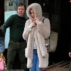 Too cute: Wearing the jacket's hood up, the blonde beauty - who is frequently seen in skimpy outfits - resembled a cute teddy bear