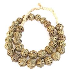 This is a strand of authentic West African lost wax Brass Trade beads. These beads were handmade from the Lost Wax technique in Ghana West Africa  100% hand made. The condition is excellent.  Size 15-16mm average size bead.  Length of the strand: 20.5 Inches  # of beads beads on a strand 35.  Shape: Cage  You will receive 35 beads
