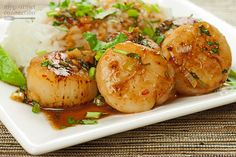 Sea scallops, lightly glazed with a combination of Thai sweet chili sauce, orange juice and orange zest makes a light weeknight meal.