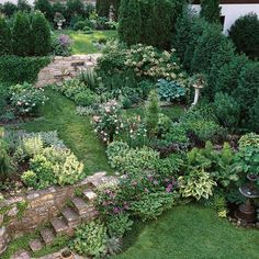 Backyard slope, divided into different levels, with stone steps.