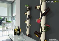 Two slim Ice Vine wine racks, each holding 10 bottles, are mounted to the wall in an open concept kitchen, the dark grey backdrop providing a perfect contrast to the sharp white epoxy powder-coated wine racks. Modern and functional, the Ice Vine is suitable to any contemporary setting, as well as to custom living and dining spaces, and can also stand freely, on a Base. (Each unit and Base sold separately. Wine bottles not included.) Wine Glass Holder, Wine Bottle Holders, Wine Bottles, White Wine Rack, Vine Wall, Open Concept Kitchen, Simple Lines, Wall Mount, Vines