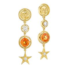 Anthony Lent Moonface earrings in gold, set with mandarin garnets, spessartite garnets and diamonds, from the Celestial collection.