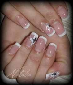 i am not fond of white tips too much, but the flowers spice it up.  I actually really like this
