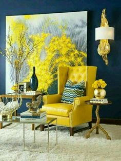 I love how bright this room is from the yellow chair and art even though the walls are deep teal