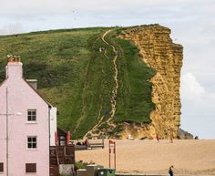 West Bay, Bridport, Dorset. A location for the TV series Broadchurch. The pink house was Stanley Kubrick's home.