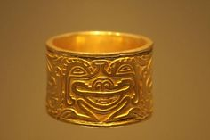 Face in a gold bracelet, Museo del Oro, (Gold Museum), Colombia <3