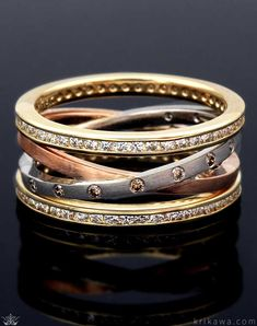 f9f321ba48ec A sophisticated blend of metals and diamonds crisscross and wrap your  finger to create this unique