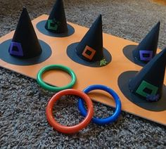 DIY game for a Halloween party- witch ring toss....this would be great for the fall festival at my school this year. (Maybe put multiples of 10 on the hats and make it an addition game.)
