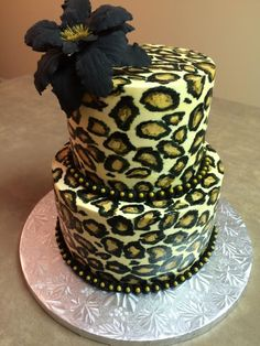 Hand painted buttercream cake with gumpaste flower. Cake was vanilla with chocolate (black and brown) leopard spots inside