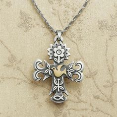 """La Primavera Gold & Silver Cross: An iconic Avery design for over 40 years, the name La Primavera is Spanish for """"the season of spring."""" This version of the design unites the Christian symbols of an ichthus and a 14k gold dove with a spring butterfly and flower to convey a harmonious expression of hope, love, and renewal. #JamesAvery #Cross"""