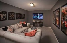 Looking for media room ideas? Frame posters of your family's favorite movies, and then add pillows and art in corresponding colors. Berkshire // Fort Worth, TX // Highland Homes // Plan 208