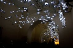 Light at the End of the Tunnel, by Leeds based artist Kirsty Ware, is a beautiful installation consisting of 1000 illuminated paper cranes that appear as if they gently fly through these darkened Town Hall prison tunnels which convey a peaceful atmosphere.