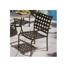 Tropitone Sorrento Stacking Patio Dining Chair Finish: Parchment, Vinyl: Parchment