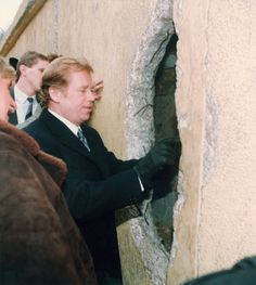 Czechoslovak President Vaclav Havel looks trough a hole of the Wall at the East side near Brandenburg Gate, Tuesday, January 02, 1990. Havel arrived here for political talks with the East German government. On his one-day-trip to both East and West Germany he will meet West German President Richard von Weizsaecker and Chancellor Helmut Kohl later the day in Munich. (AP)
