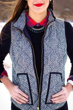 The Oh So Popular Herringbone Vests are back and are an absolute must have for Fall and Winter! This is a lightweight vest that features a printed herringbone fabric with front pockets and a gold zipp