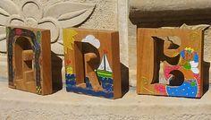 La Cacharperie - objetos de diseño Letras de madera calada y pintada a mano.