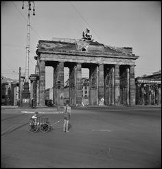 by David Seymour - GERMANY. Berlin. 1947. Boy pulling a wagon in front of the Brandenburg Gate // Magnum Photos