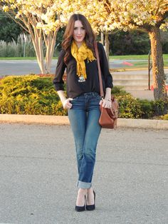 Jeans, black blouse and yellow scarf