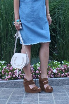 Perfect summer outfit. Light weight chambray dress with wide brimmed hat, wedges, and Chloe bag.