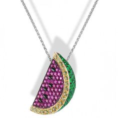 """Watermelon"" pendant in white gold set with 78 dark pink sapphires, 56 emeralds, 19 peridots and 6 black sapphires. Chain in white gold by de Grisogono"