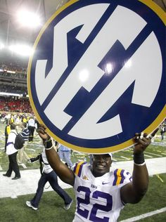 LSU's Ryan Baker shows off an SEC logo after beating Georgia in the 2011 SEC title game. UT is trying to play a more physical game, which is a hallmark of that conference.