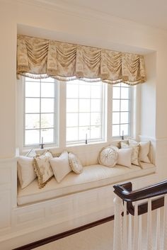 Window treatment for a window seat.  There's one option. Skip the curtains. But…